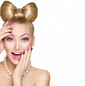 stock photo of emotional  - Beauty fashion happy surprised model girl with funny bow hairstyle - JPG