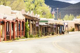 stock photo of pueblo  - Buildings in Taos which is the last stop before entering Taos Pueblo New Mexico - JPG