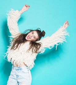 pic of crazy face  - studio portrait of cheerful fashion hipster girl going crazy making funny face and dancing - JPG