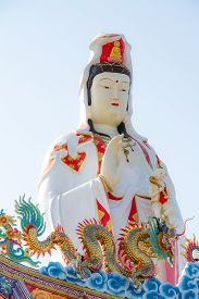 picture of pronunciation  - Guanyin statue and dragon in Mahayana Buddhism - JPG
