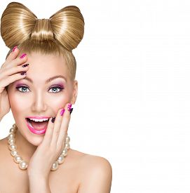 foto of emotion  - Beauty fashion happy surprised model girl with funny bow hairstyle - JPG