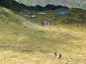 Small Trekkers In Big Mountains With Many Lakes, Aiguillette Des Houches, Brevent, France, The Alps poster