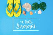 Hello Summer Text On Blue Background, Yellow Sandals With Green Tropical Palm Leaf And Shell. Beach  poster