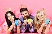 Lovers Drinking Coffee In Bed. Man And Women In Domestic Clothes, Pajamas. Man And Women, Friends On poster