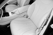 White Leather Interior Of The Luxury Modern Car. Leather Comfortable White Seats And Multimedia. Ste poster
