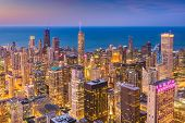 Chicago, Illinois, USA aerial downtown skyline at dusk towards Lake Michigan. poster