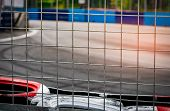 Metal Net Fence Behind Tire Protection For Racing Car Crash In Race Track. Red And White Tyres Safet poster