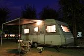 pic of travel trailer  - European mobile home on a camping site at night - JPG