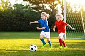 Kids Play Football. Child At Soccer Field. poster