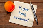 enjoy long weekend - handwriting on a napkin with a fresh apricot poster