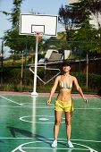Beautiful Young Woman Playing Basketball Outdoors. The Girl Basketball Player Have Training And Exer poster