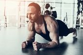 Bearded Young Man In Shirt Training In Fitness Club. Man With Athletic Body. Healthy Lifestyle And S poster