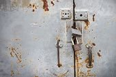 Old Iron Door That Is Securely Locked. Old Rusted Iron Door With Locked Locks. poster