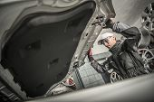 Car Mechanic Opening Vehicle Hood. Auto Service Concept. Caucasian Technician. poster