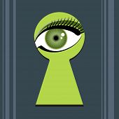 stock photo of voyeur  - Green eye spying through a key hole - JPG