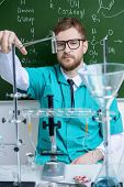 Smartman scientist making chemical experiments in the laboratory. Educational concept. Discovery.  poster