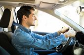 Profile View Of An Good Looking Young Man Driving A Car And Paying Attention To The Road, Man Wearin poster