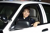 picture of lightbar  - a female police officer sitting in her patrol car during a night shift - JPG