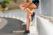 foto of hurted  - knee injury for athlete runner - JPG