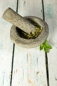 Dried stevia sugar substitute with mortar and pestle