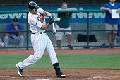 CENTRAL ISLIP-JULY 21: Long Island Ducks infielder Brandon Sing (23) singles against the Sugar Land