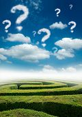 stock photo of question-mark  - A maze under a blue sky with question mark clouds - JPG