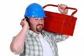 picture of unawares  - Tradesman pretending to listen to music - JPG
