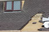 foto of leaked  - roofing repairs being carried out on a leaking roof - JPG