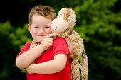 pic of night gown  - Portrait of boy playing with his stuffed animal pet - JPG