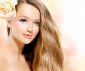 Beauty Girl. Beautiful Model Face. Healthy Long Hair and Perfect Clear Skin. Youth. Isolated on Whit