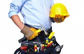 stock photo of carpenter  - Worker with a tool belt - JPG