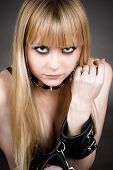 stock photo of debauchery  - portrait of the blond with leather handcuffs - JPG