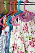 image of habilis  - Closet with  fashion baby dresses on hangers - JPG