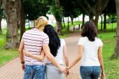foto of cheating  - a young man cheating on his girlfriend by holding another womans hand behind her back - JPG