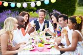 foto of dress-making  - Group Of Friends Enjoying Outdoor Dinner Party - JPG