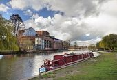 stock photo of avon  - Narrowboat moored on the River Avon by the Royal Shakespeare Company theatre - JPG