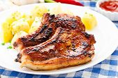 stock photo of pork cutlet  - Fried pork loin with potato on a plate - JPG