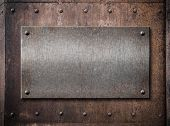 pic of battleship  - old metallic plate over rust metal background - JPG