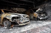 image of scrap-iron  - Close up photo of a burned out cars in garage after fire for grunge use - JPG