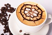 picture of scum  - Cappuccino cup with drawing on scum and coffee beans - JPG