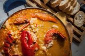 picture of lobster  - traditional seafood rice with lobster and tomato sauce - JPG