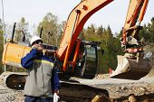 pic of jcb  - construction worker talking in phone - JPG