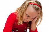 stock photo of saddening  - beautiful girl is upset and saddened scowls down - JPG