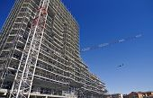 picture of scaffold  - Scaffolding on a construction site of a new building - JPG
