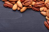 pic of pecan nut  - Background texture of assorted mixed nuts including cashew nuts, pecan nuts, almonds ** Note: Shallow depth of field - JPG