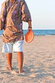 picture of frisbee  - young boy playing frisbee on the beach - JPG