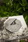 image of sundial  - A stone sundial, Dunster Park, Devon, England