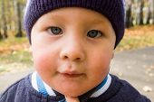 image of squinting  - Of Caucasian boy with poor eyesight  - JPG