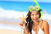 stock photo of watersports  - Beach travel woman with snorkel and starfish on vacation in bikini enjoying summer vacation holidays on tropical resort by ocean sea - JPG