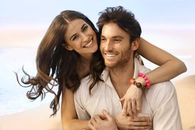 picture of married  - Portrait of happy casual caucasian married couple at the beach - JPG